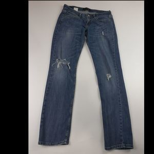 LEVIS TOO SUPER LOW 524 STRETCHY DISTRESSED JEANS